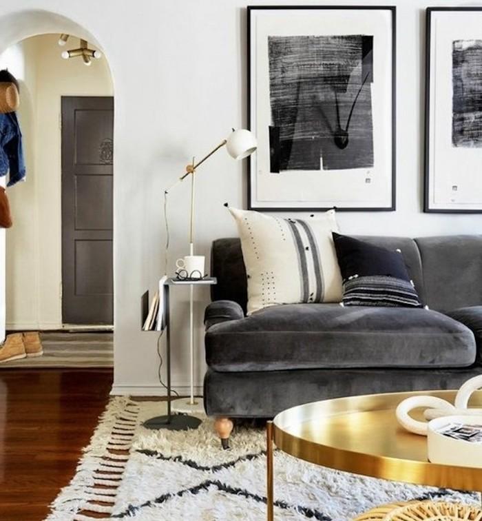 beautiful living rooms, grey velvet sofa, brass coffee table, white walls, wooden floor, white carpet