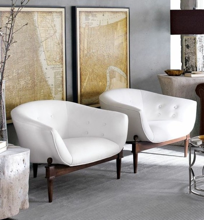 white leather armchairs, framed vintage maps, colors that go with gray walls, grey carpet