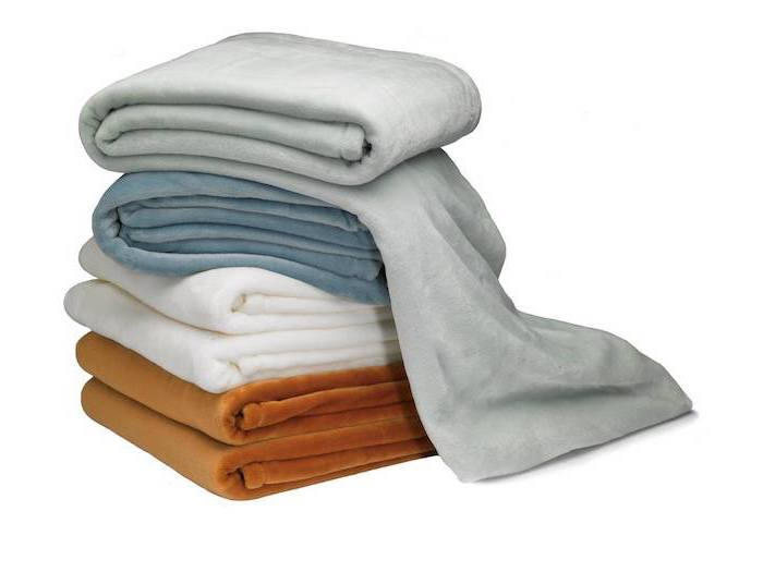 set of blankets, practical housewarming gifts, white and brown, grey and blue blankets