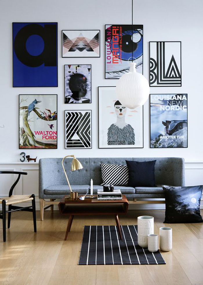 hanging art, grey sofa, small black and white rug, small room decor, wooden coffee table, wooden floor