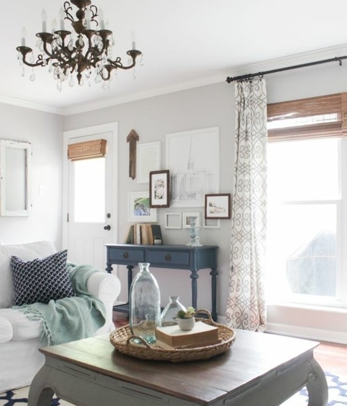 vintage wooden coffee table, white sofa, beautiful living rooms, white walls, hanging chandelier
