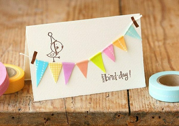 happy bird day, colourful hanging garland, birthday card ideas for mom, wooden table, washi tape