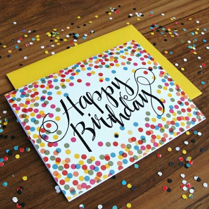 colourful confetti, drawn on white card stock, cool birthday cards, yellow envelope, wooden table