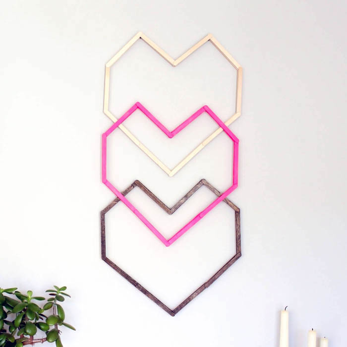 hanging on a white wall, three heart intertwined, beige pink and brown, canvas art ideas