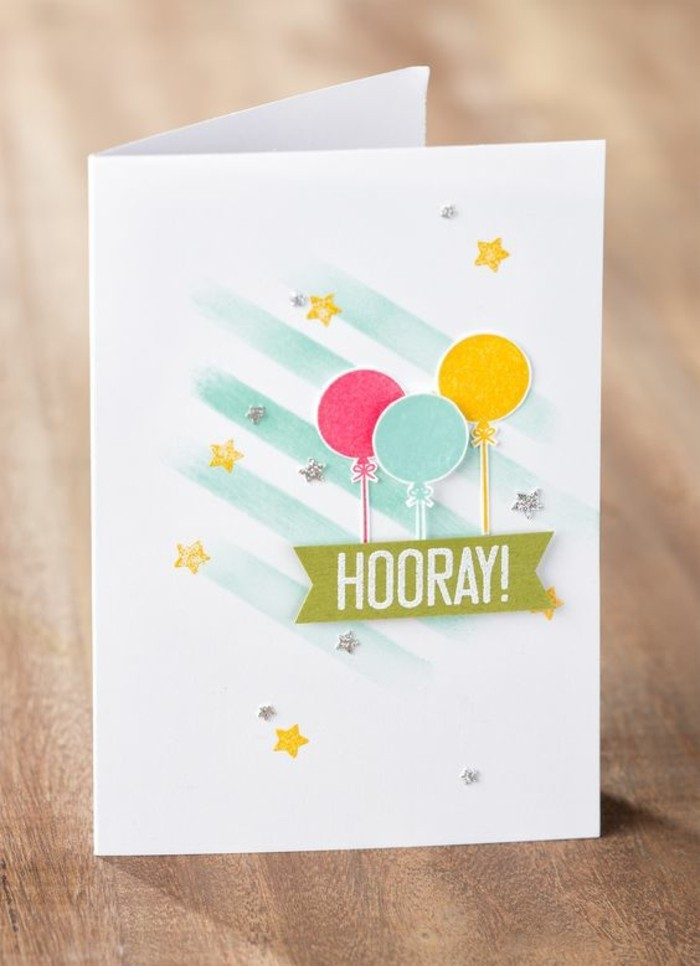 pink blue and yellow balloons, on white card stock, best birthday cards, wooden table