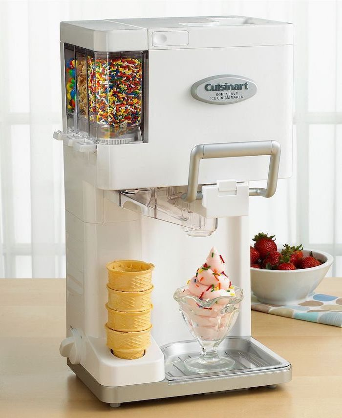 ice cream maker, with cones and sprinkles, practical housewarming gifts, wooden table, strawberries in a bowl