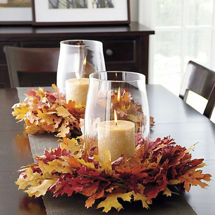 fallen leaves, large glass vases on top, candles inside, kitchen table decor, wooden table and chairs