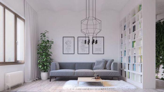 grey velvet sofa, living room arrangements, white wooden bookshelf, hanging art, wooden floor