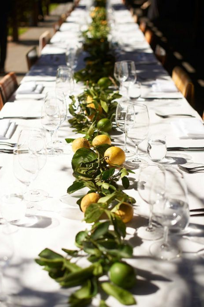 lemons and lemon tree branches, table runner, center table decor, wine glasses, table settings
