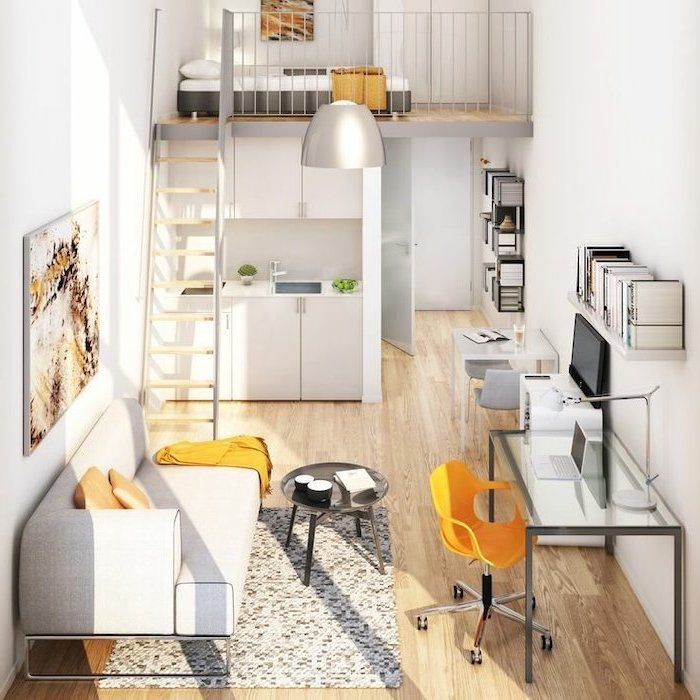 how to decorate a small living room, two level studio apartment, white sofa, small metal coffee table