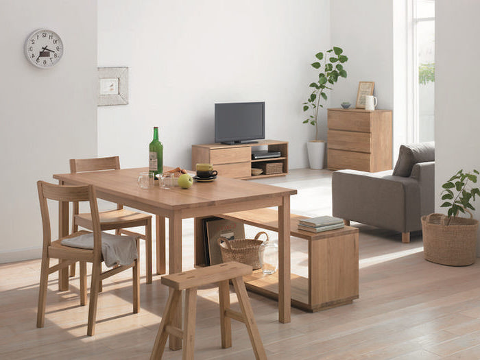 small apartment decorating ideas, wooden table, chairs and bench, grey sofa, white walls, wooden floor