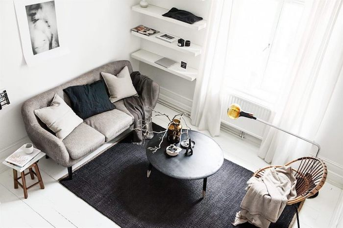 grey sofa, black metal coffee table, black carpet, small apartment decorating ideas, white shelves