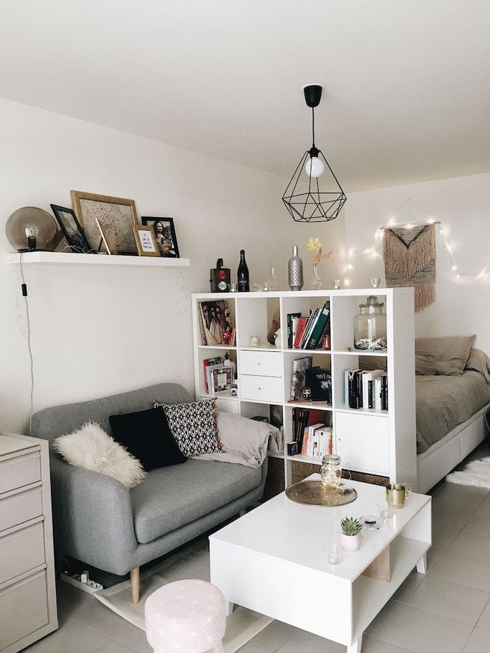 white bookshelf, room divider, small grey sofa, white coffee table, small apartment decorating ideas, tiled floor