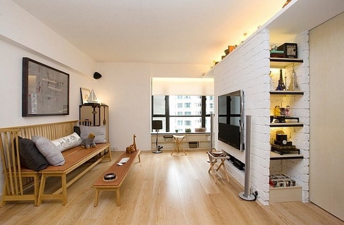 white brick wall, small apartment decorating ideas, wooden floor, wooden bench, small coffee table