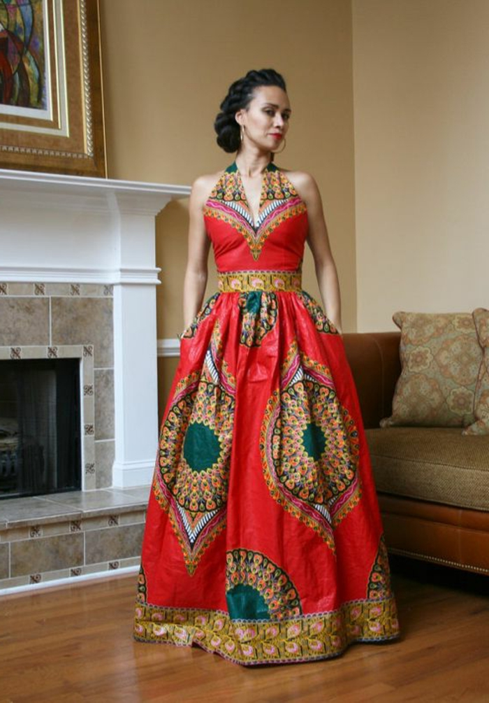 long dress, braided black hair, african dress designs, wooden floor, fireplace in the background