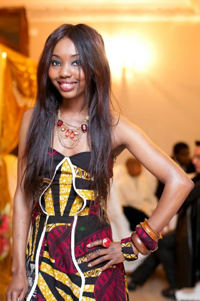 long black hair, long dress, large wooden bracelets, african dress designs, large golden necklace