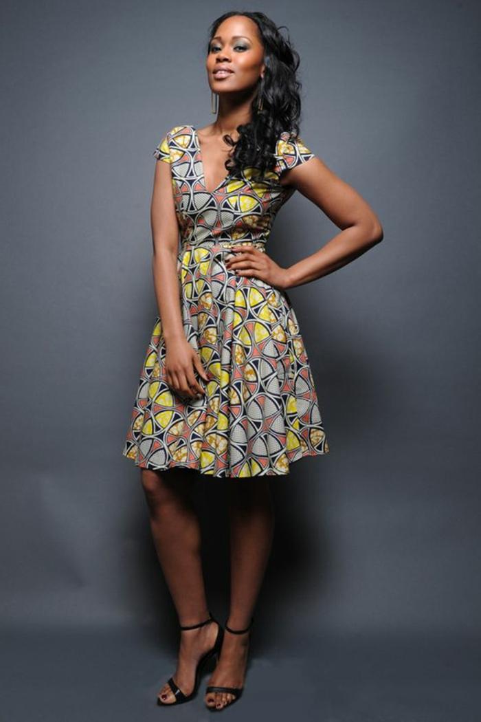 long black curly hair, mid length dress, african dress designs, black high heel sandals, grey background