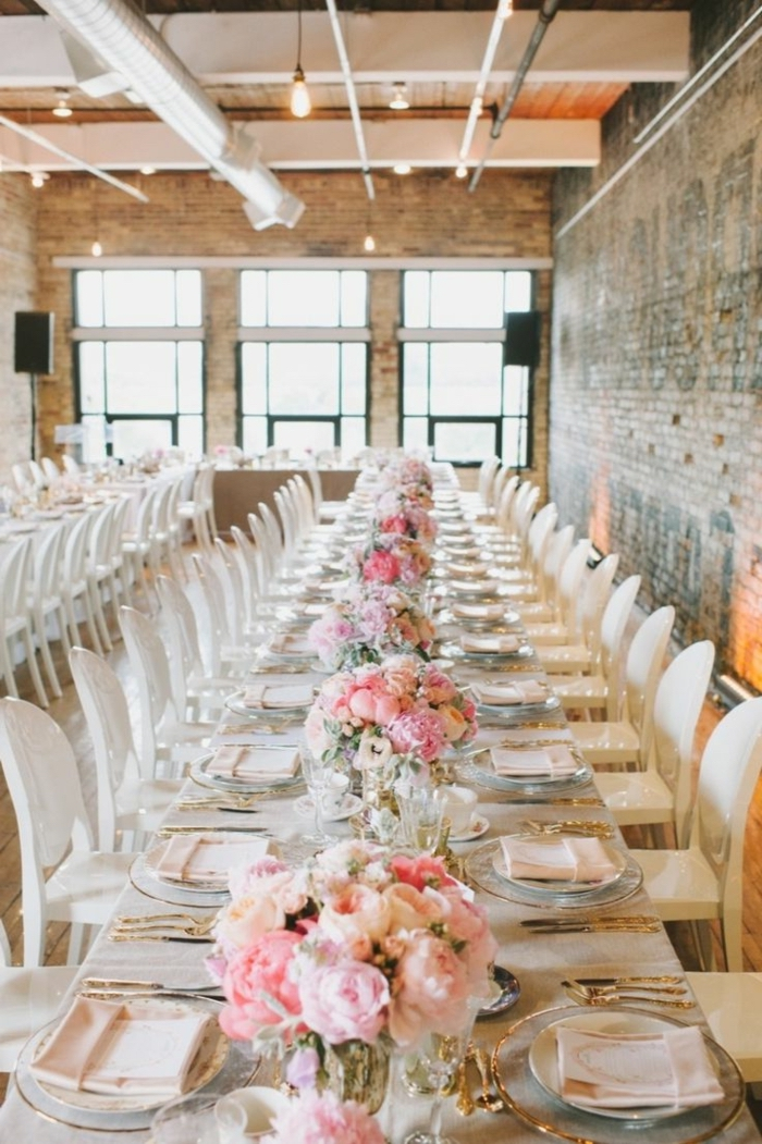 long dining table, bouquets of roses, center table decor, table settings, white chairs, industrial style