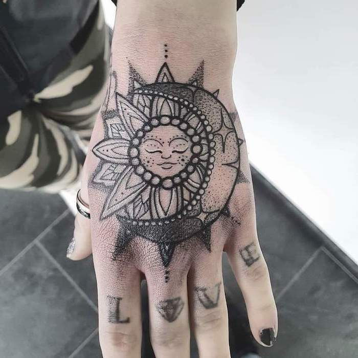 sun and moon, hand tattoo, love knuckles tattoo, what does mandala mean, black tiled floor, navy pants
