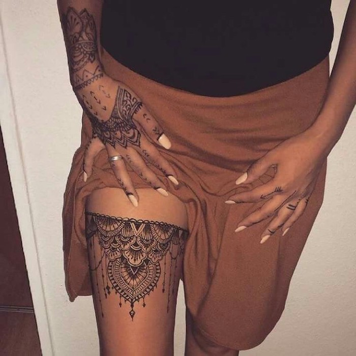 brown skirt, thigh tattoo, hand tattoo, mandala back tattoo, white background, black top