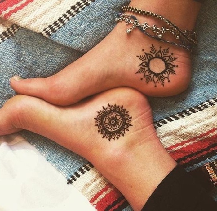 silver bracelets, matching ankle tattoos, mandala back tattoo, colourful blanket