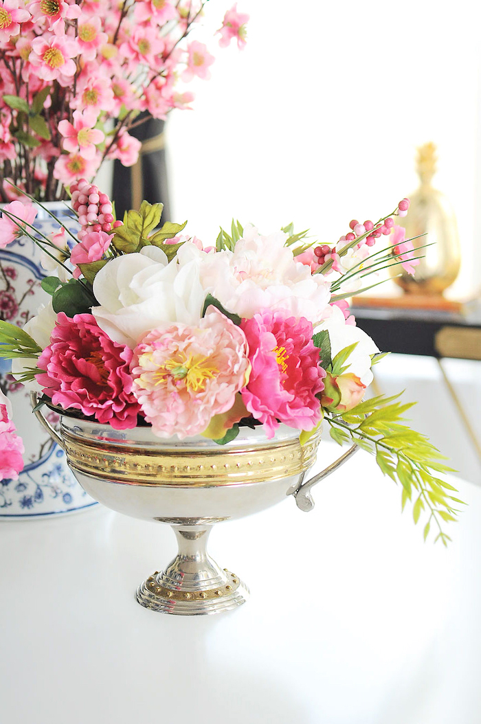 silver metal bowl, full of white and pink, flower bouquet, table centerpieces, white table