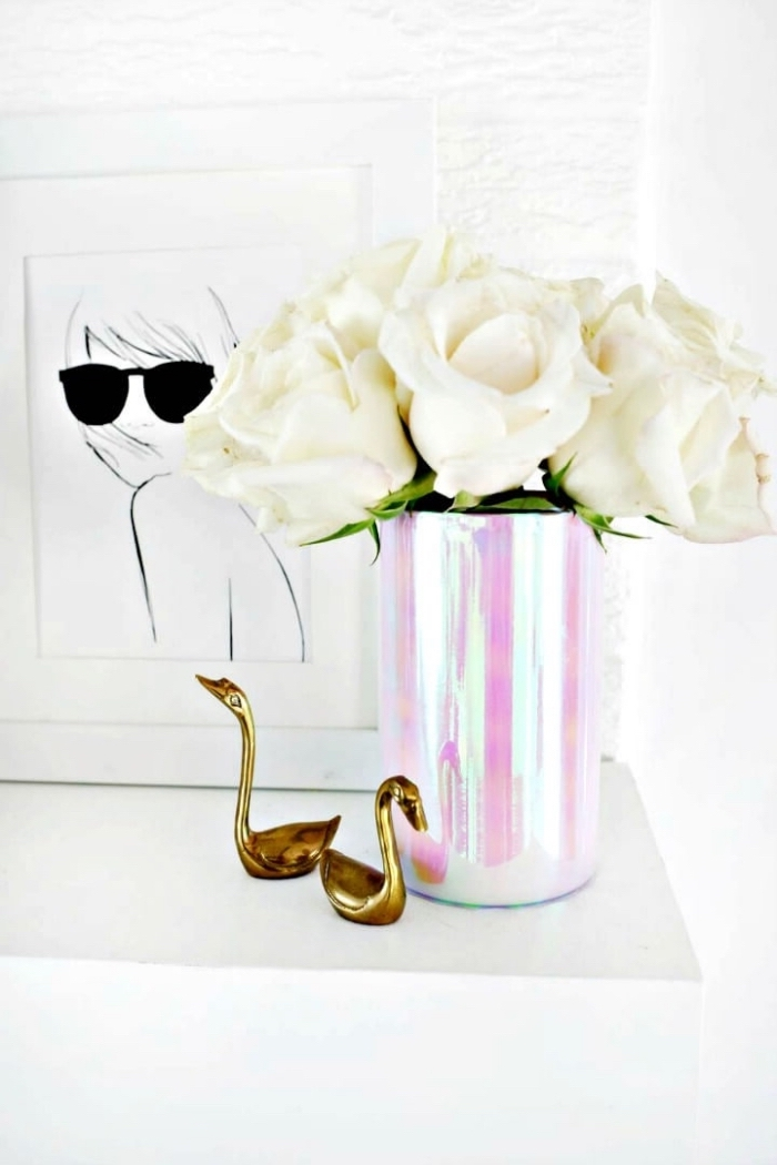 monochromatic vase, bouquet of white roses, table setting ideas, metal swan figurines, framed drawing