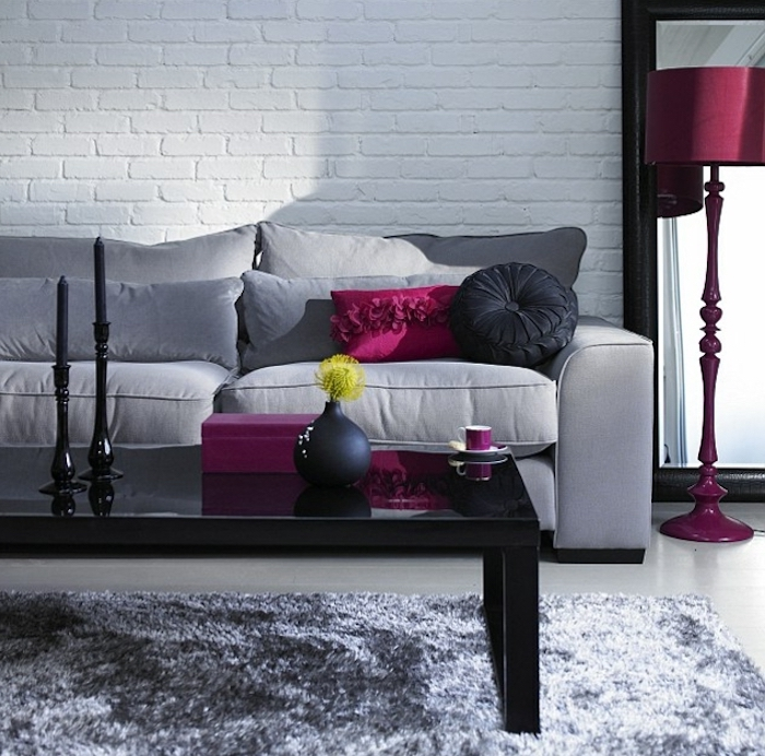 grey sofa, pink and black throw pillows, pink lamp stand, gray color schemes, black coffee table