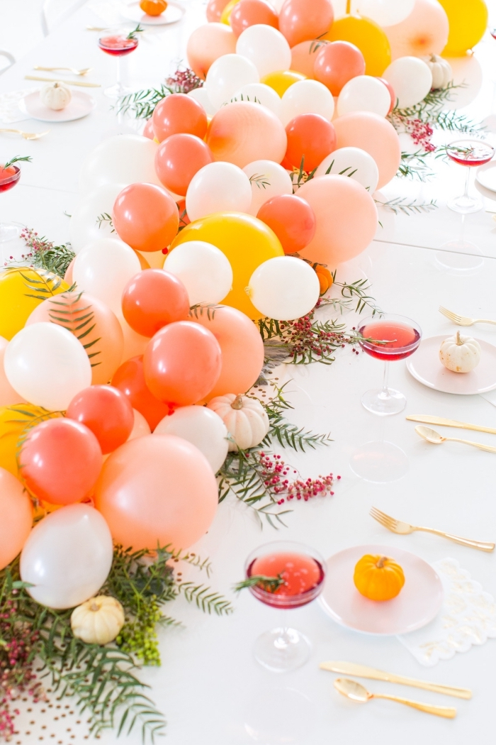 orange white and yellow balloons, table runner, centerpiece ideas, on a white table, wine glasses
