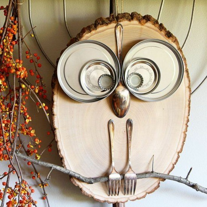 wooden block, metal plates stuck to it, in the shape of an owl, diy art projects, popped on a tree branch