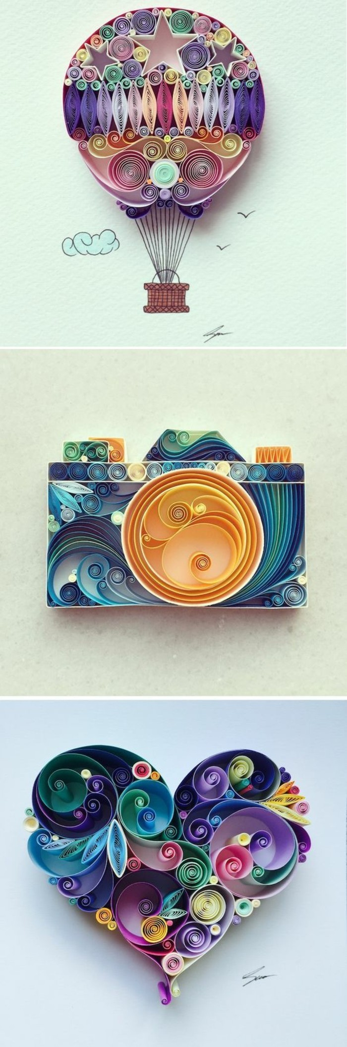 hot air balloon, photo camera and a heart, made out of colourful paper, living room wall ideas
