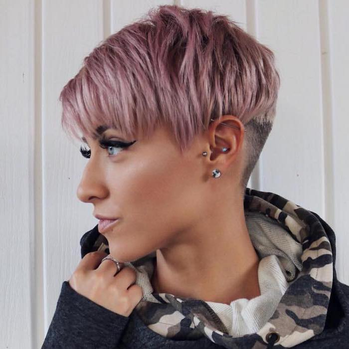 pink pixie cut, short to mid length hairstyles, navy hoodie, white background