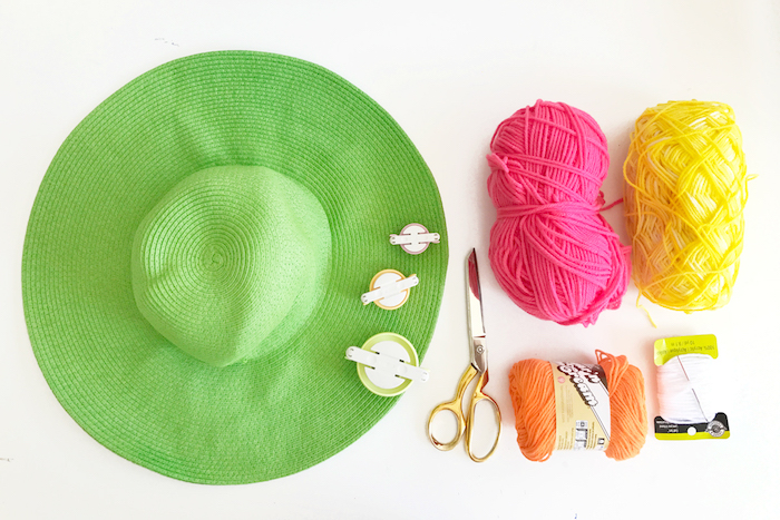 large green hat, yellow pink and orange yarn, diy anniversary gifts for him, step by step, diy tutorial