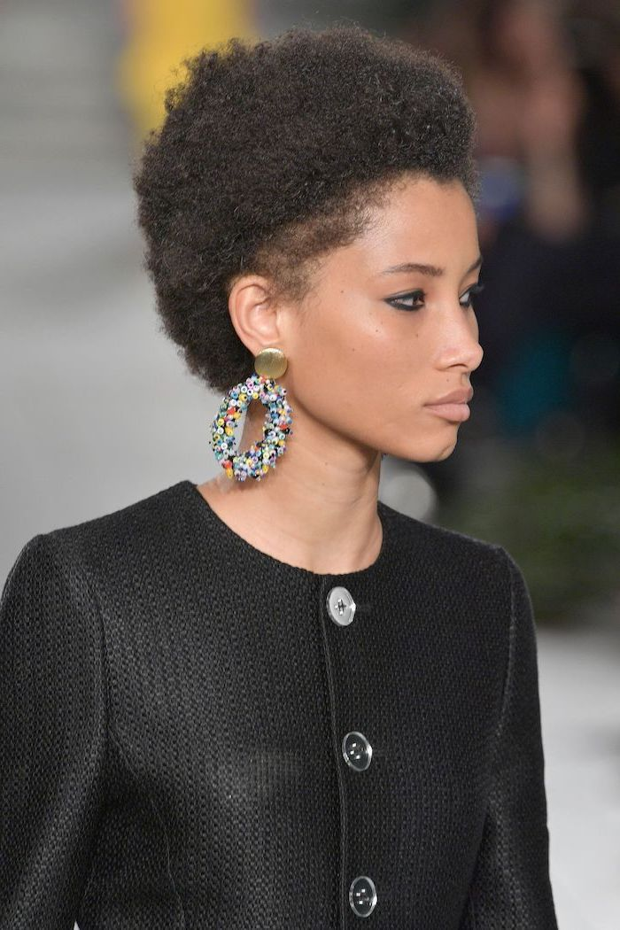 black curly hair, medium hair cuts for women, black blazer, floral earrings