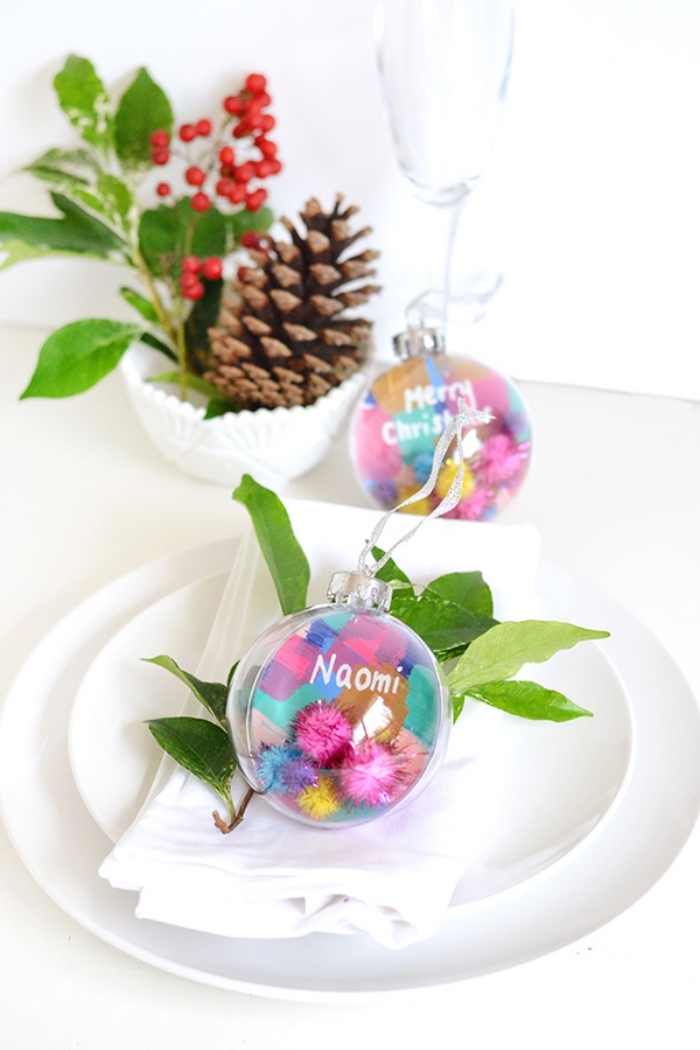 white plates, colourful baubles, dining table centerpieces, pine cone, tree branch, inside a bowl