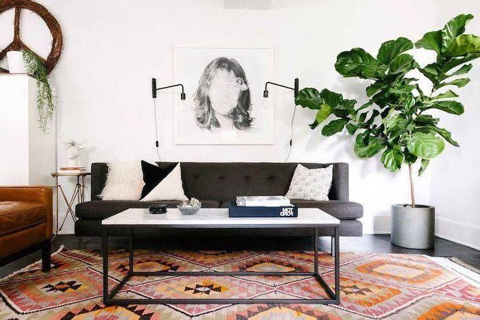 dark grey sofa, metal coffee table, marble countertop, small living room layout, printed carpet, hanging art