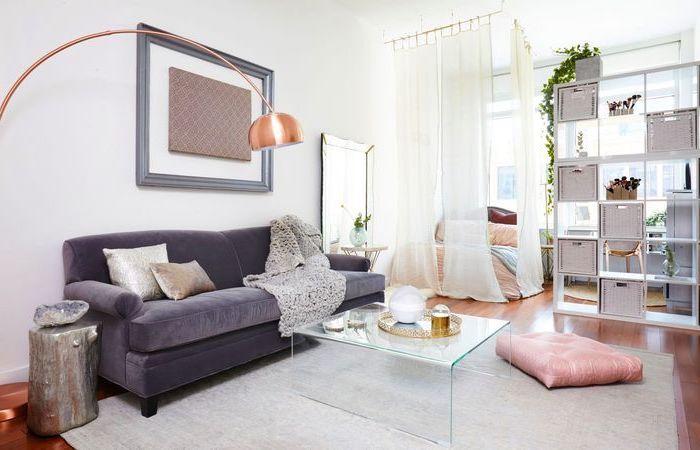 purple velvet sofa, small living room ideas, glass coffee table, white curtains, small wooden bookshelf