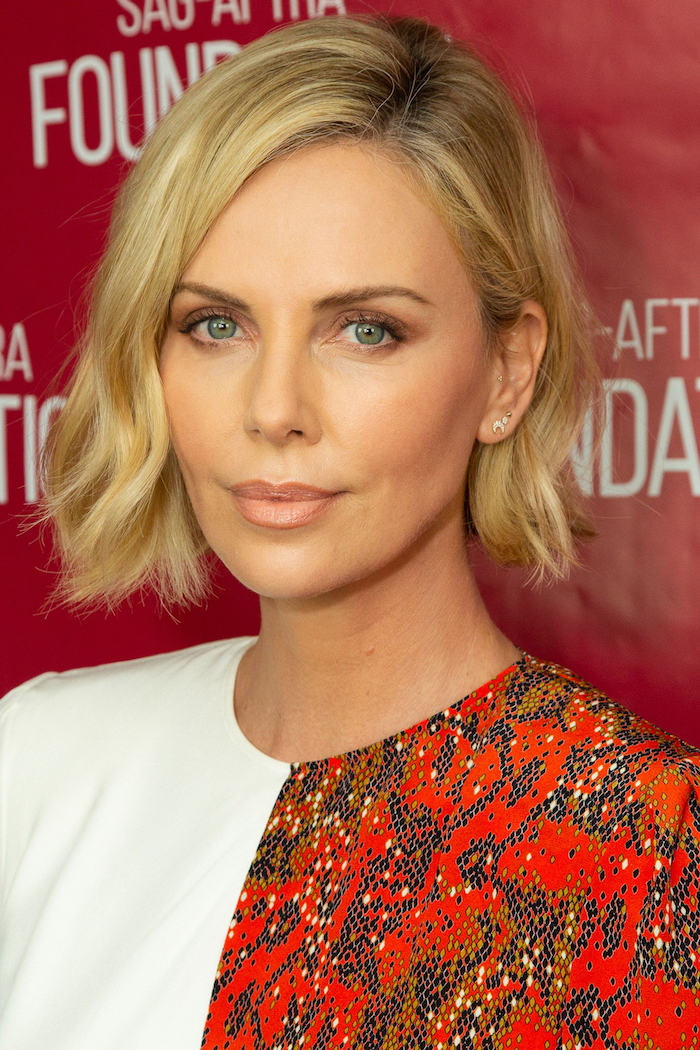 short haircuts for women, charlize theron, blonde hair, white printed dress