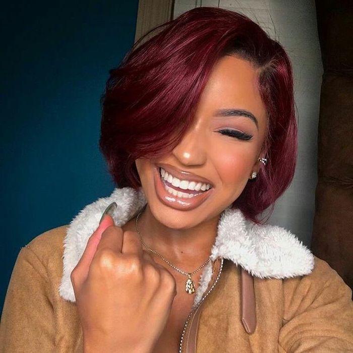 red hair, asymmetrical short hair, brown velvet jacket, blue background