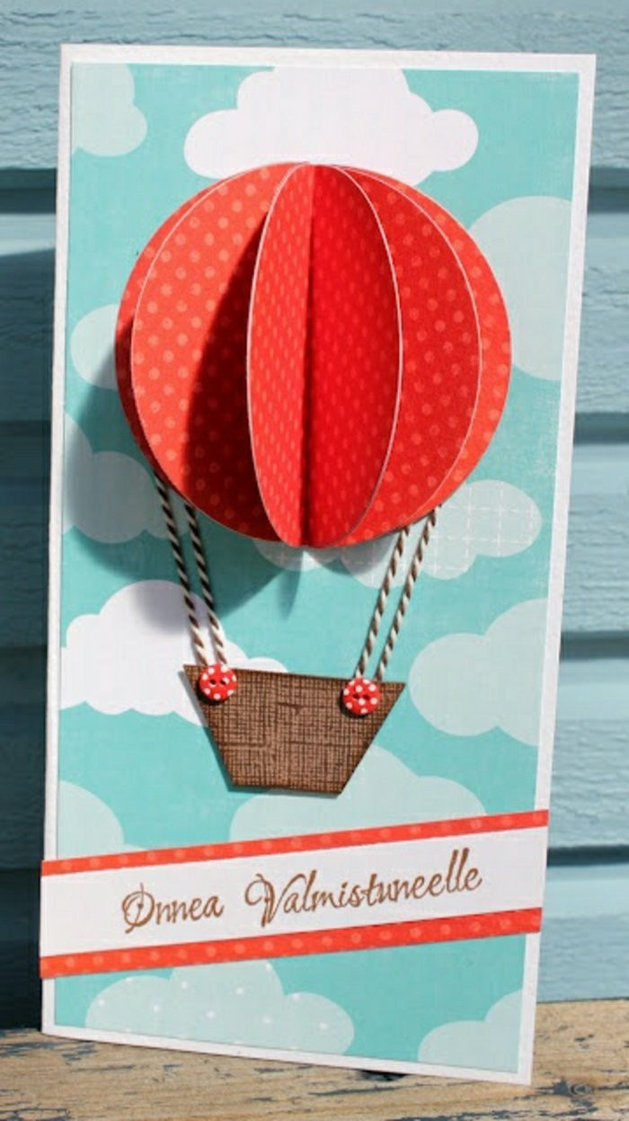 red hot air balloon, card making ideas, blue skies, blue wooden background, red and white strand