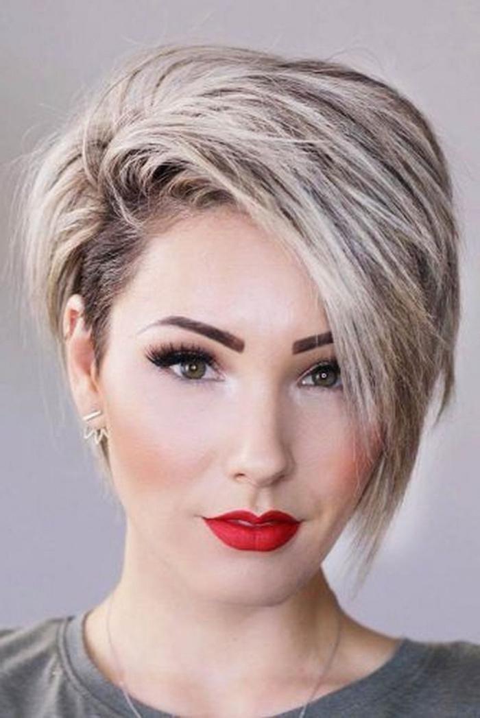 red lipstick, blonde hair, asymmetrical short hair, white background, grey shirt