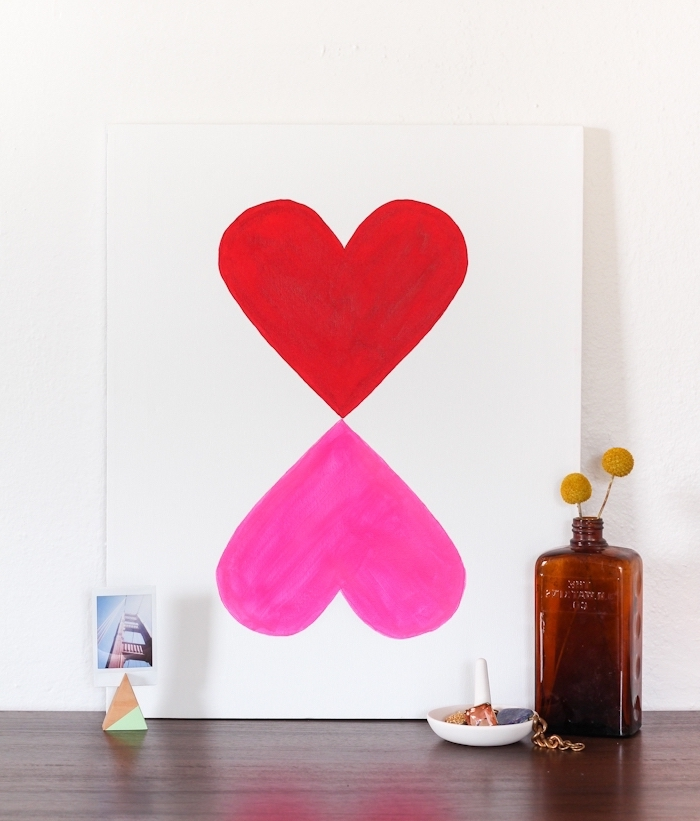 painting on a wooden table, diy wall art, pink and red heart, painted on a white canvas, mirror images