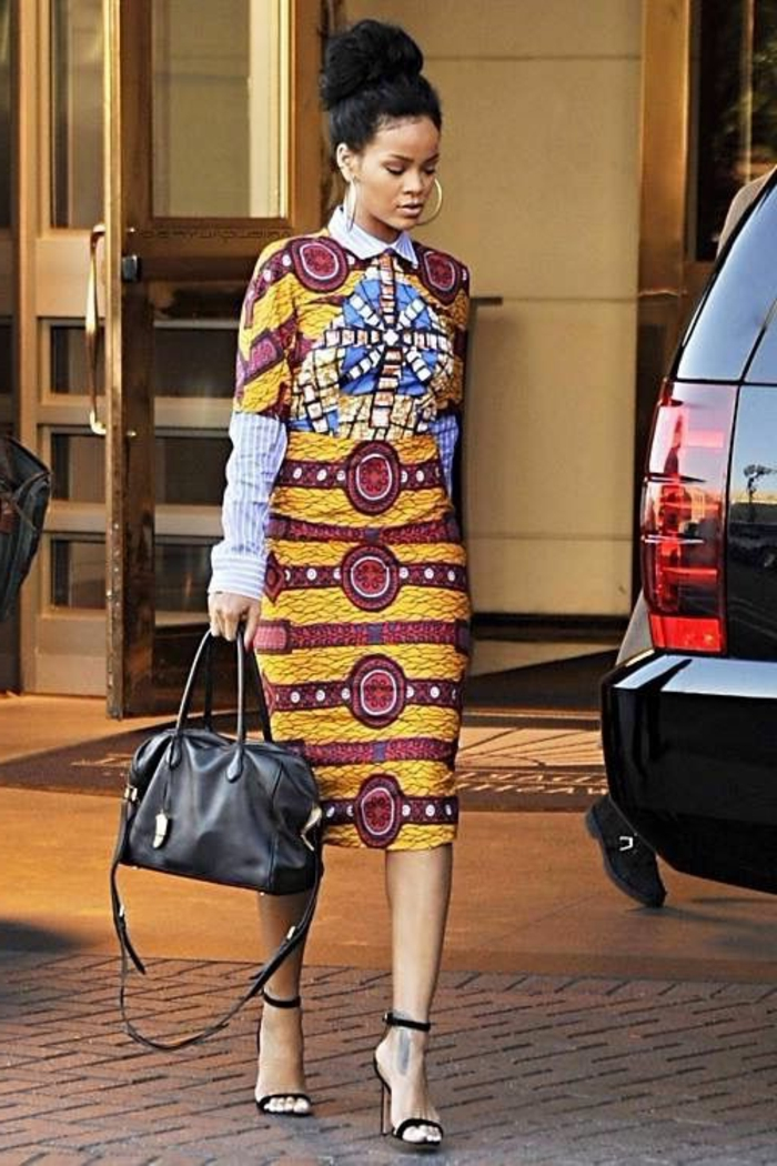 rihanna walking, down a paved street, mid length dress, blue shirt, african dresses, black car