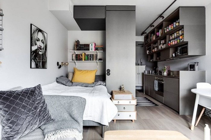 grey kitchen, wooden floor, small living room layout, grey sofa, grey velvet throw pillow, white walls