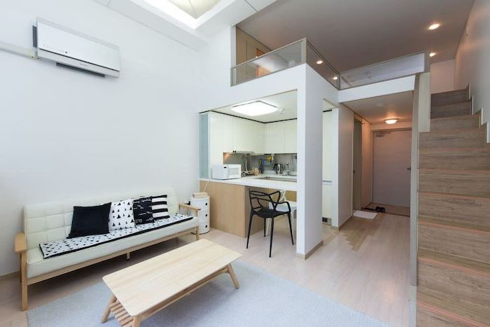white sofa, small wooden coffee table, couches for small living rooms, two level studio apartment