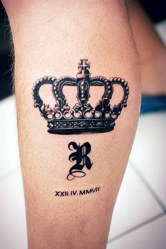 crown leg tattoo, roman numeral tattoos on arm, white tiled floor