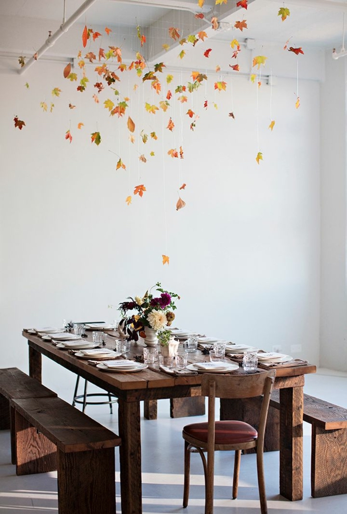 fallen leaves, hanging from the ceiling, wooden table and benches, flower bouquet, dining table decor ideas