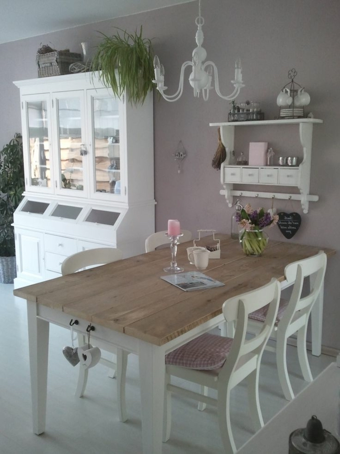 wooden table and chairs, dining table decor ideas, plastic candle holder, flower bouquet, purple walls