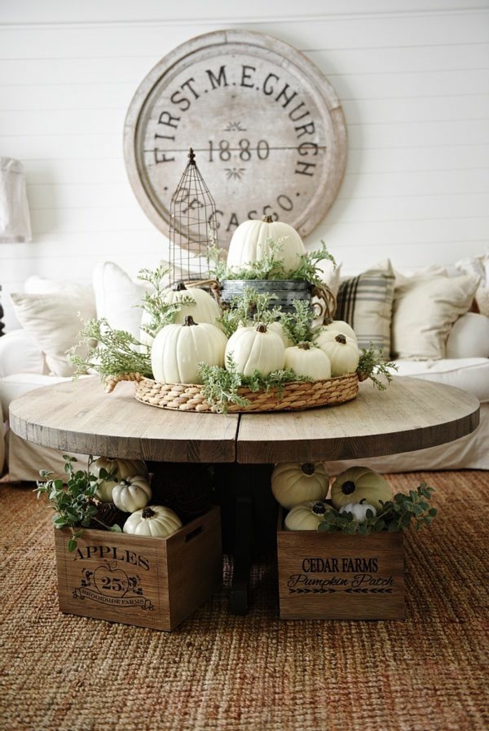 small round, wooden coffee table, wooden tray, full of white pumpkins, dining table decor ideas, wooden crates