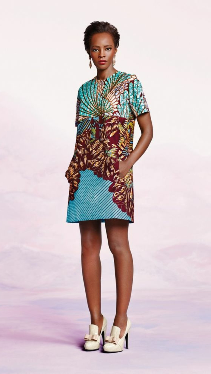 short dress, white high heels, pink background, brown hair, in a low updo, african formal dresses